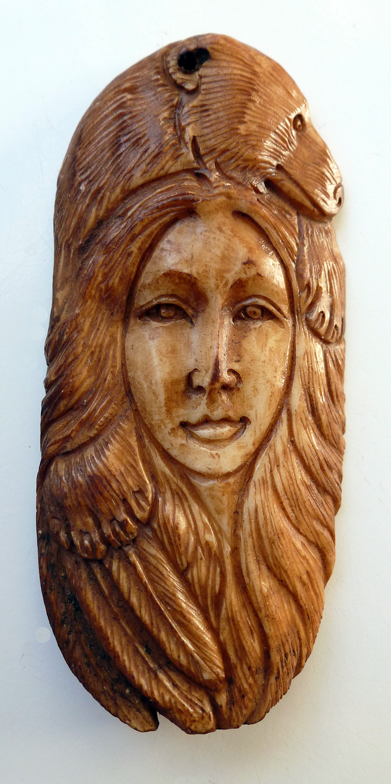 Bone Carving of Bear Woman Totem