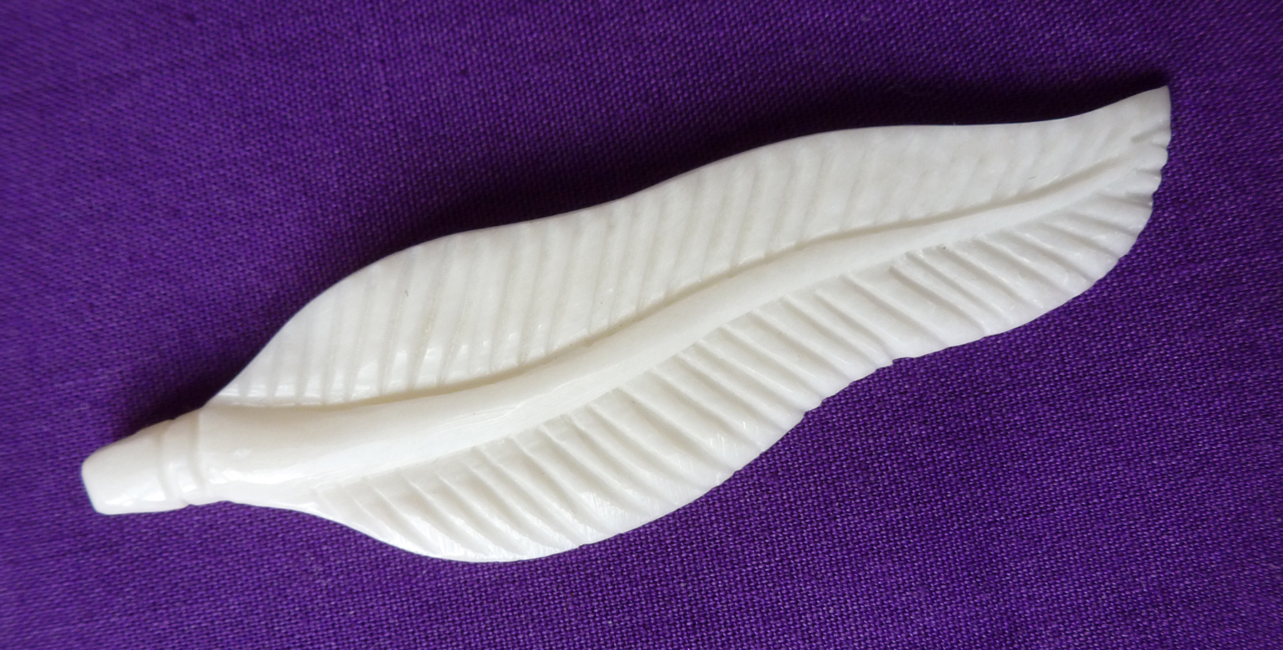 Bone carved feather