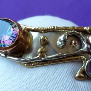 Mystic topaz bangle in tricolour metals.