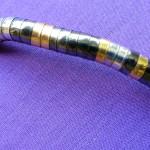 Bendable tricolour metal necklace close up